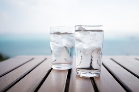 2 Glasses of Clean Water on Tabletop