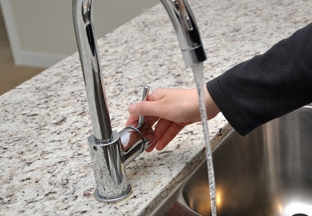 Woman Checking Tap Water