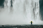 Man in the Midst of a Waterfall